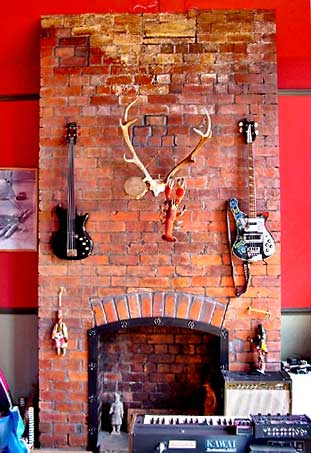 bassHangings Fireplace with bass guitars, antlers, lobster and tambourine